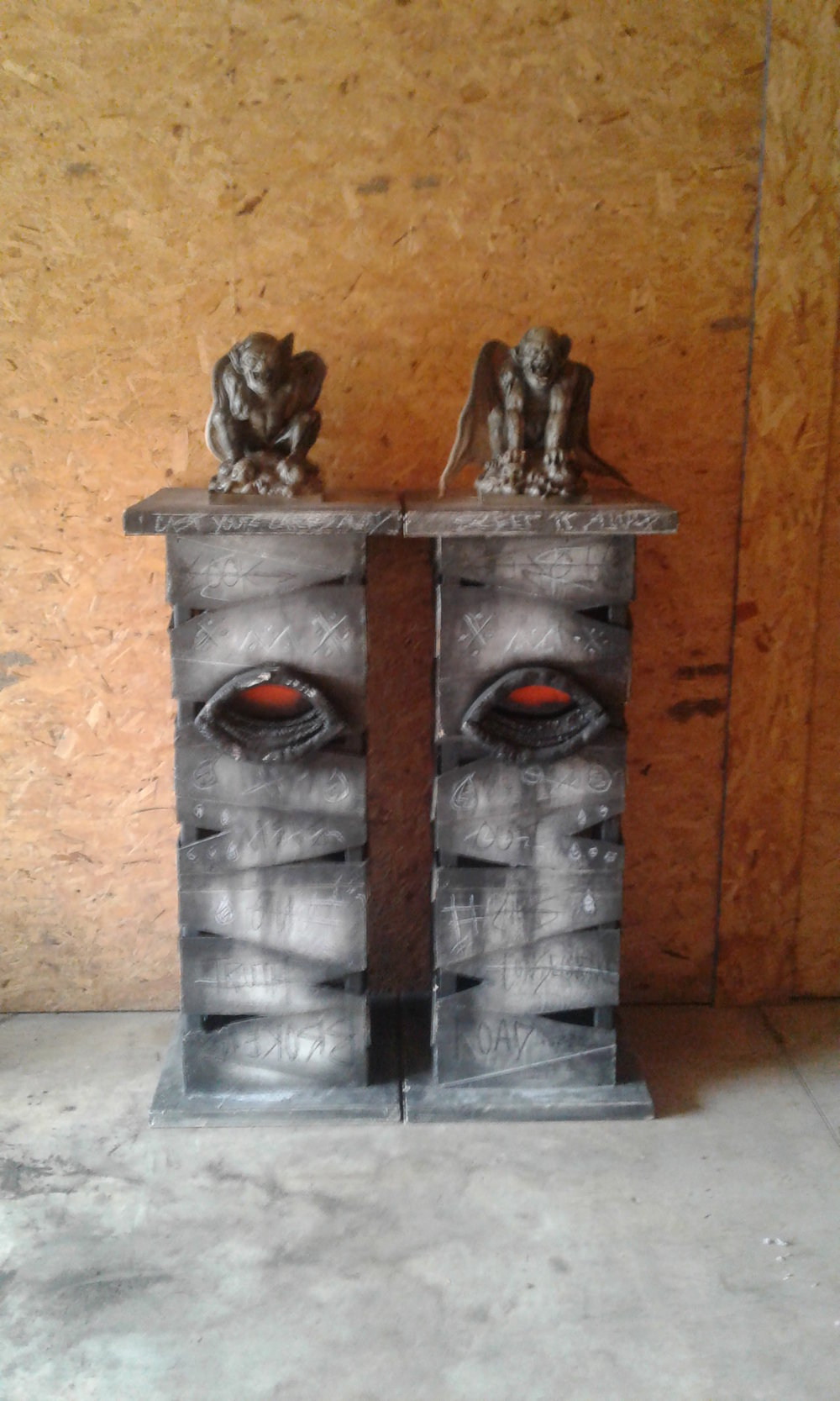 Graveyard set entry columns.  Hand fabricated and painted.  Both feature inner lighting and illuminated eyes.