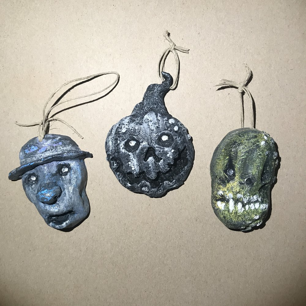 Handmade ornaments  Sculpted in clay, molded in silicone, and cast in resin.