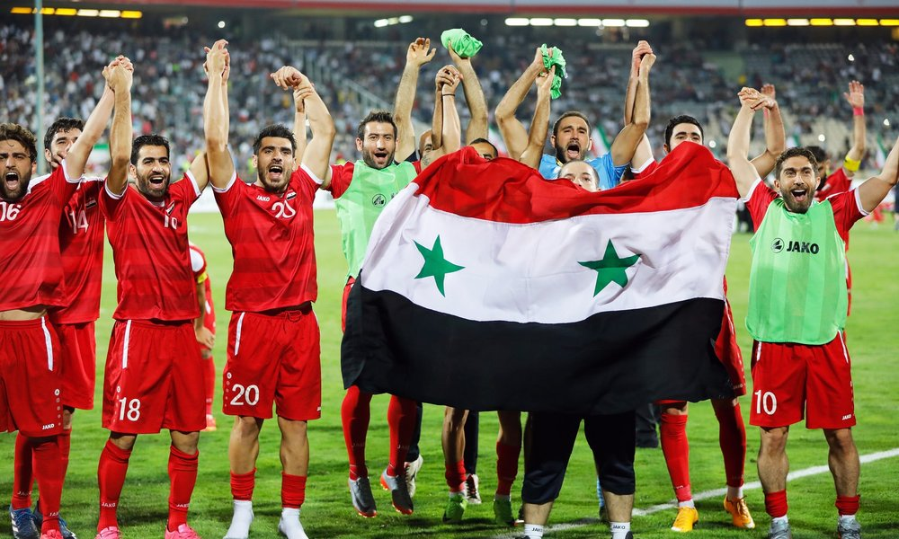 Syria reach World Cup play-off with Australia after late equaliser in Iran - Syria's players celebrate after their 2-2 draw in Iran secured in the final minute which secured them a play-off place against Australia. Photograph: Abedin Taherkenareh/EPA