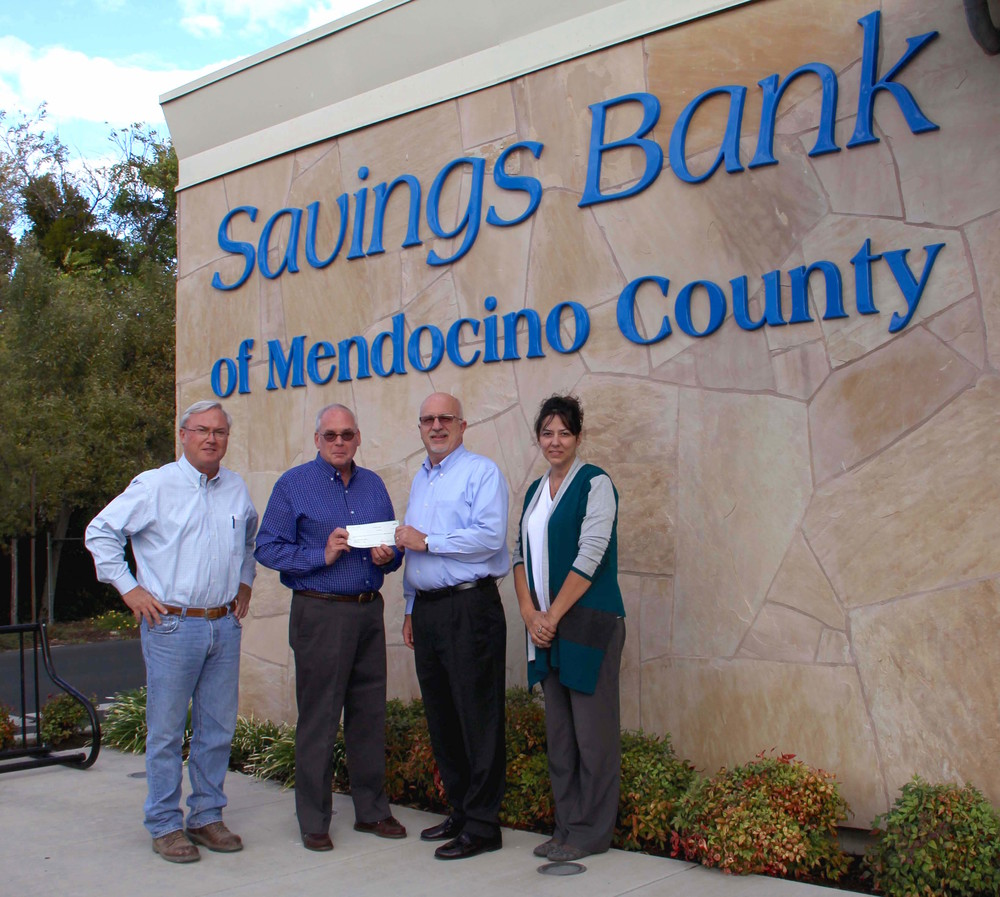 Savings Bank of Mendocino County donated $20,000 to #LakeCountyRising. In this photo: David Weiss, SBMC Board Member; Bill Groody, Lake County Wine Alliance Board Member; Pete Dodson, SBMC Loan Officer; and Susie Robinson, SBMC Lakeport Branch Manager.