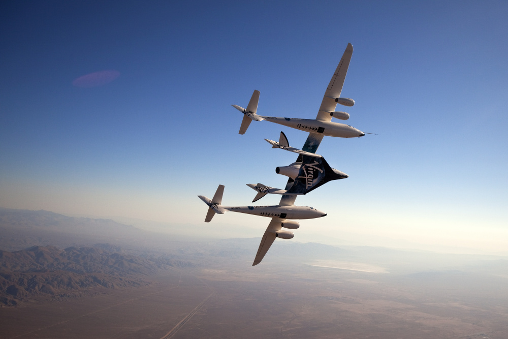 The beautiful Virgin Galactic (with White Knight Mothership) airborne over the Spaceport, New Mexico.