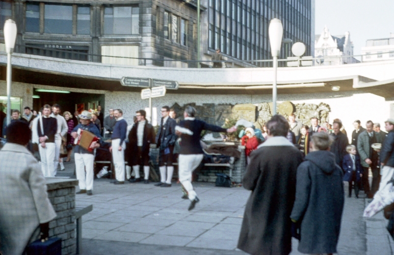 Morris dancers at the Priory Ringway, with the Old Square Mural and Lewis's department store in the background. This photo was taken in 1969 and is from the collection of the late Phyllis Nicklin.