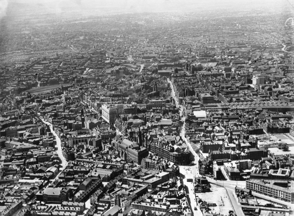 Birmingham from the air (1930s)   Corporation Street and Colmore Row can be seen, along with landmarks such as St Phillip's Cathedral, the Council House and the Town Hall, and the old New Street and Snow Hill stations.