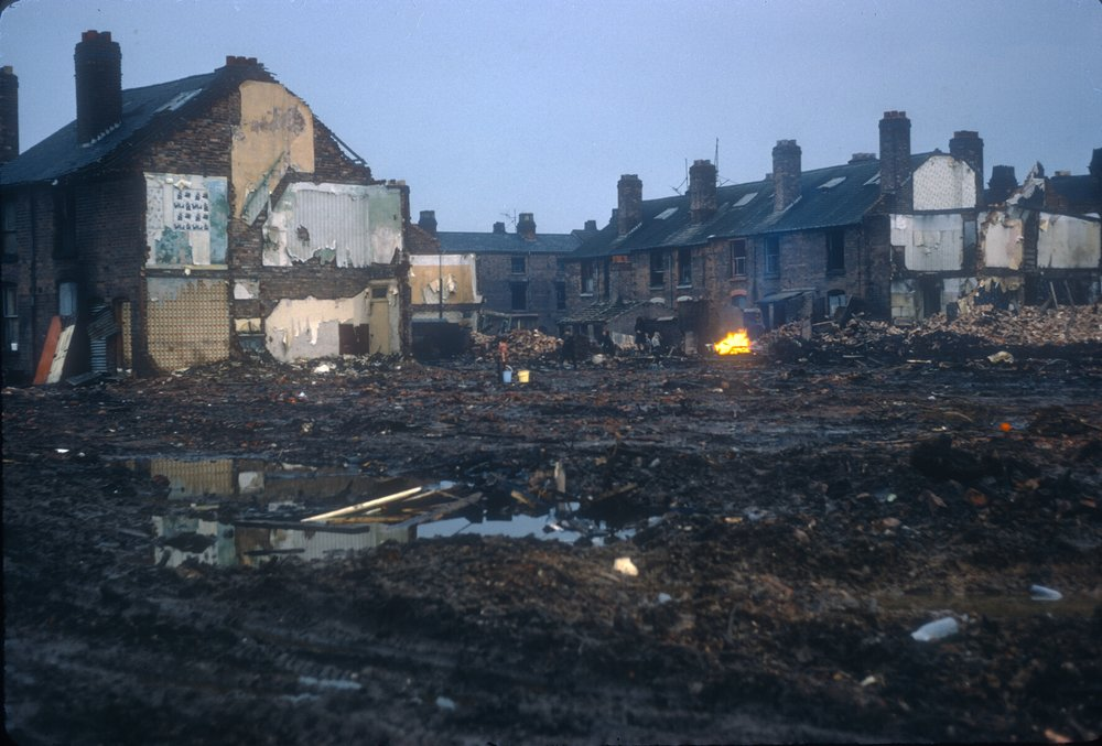 Ladywood, Demolition at the back of Anderton St off King Edwards Rd. Children playing on Saturday afternoon, fetching water from the tap (a former court) 10th February 1968