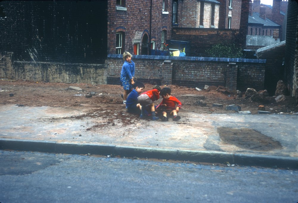 Ladywood, Hyde Rd (corner of Clark St) children playing in sand. Houses built c.1870. 14th September 1968