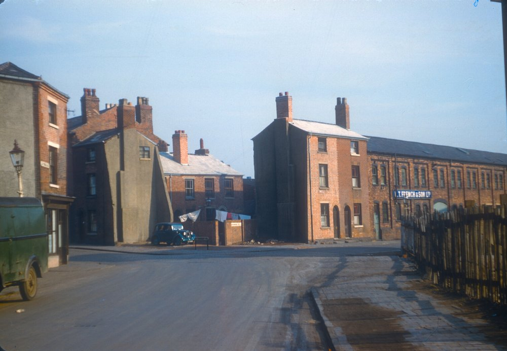 Ladywood, St Vincent St and Browning St.Tiles removed from houses awaiting demolition. 2nd March 1957