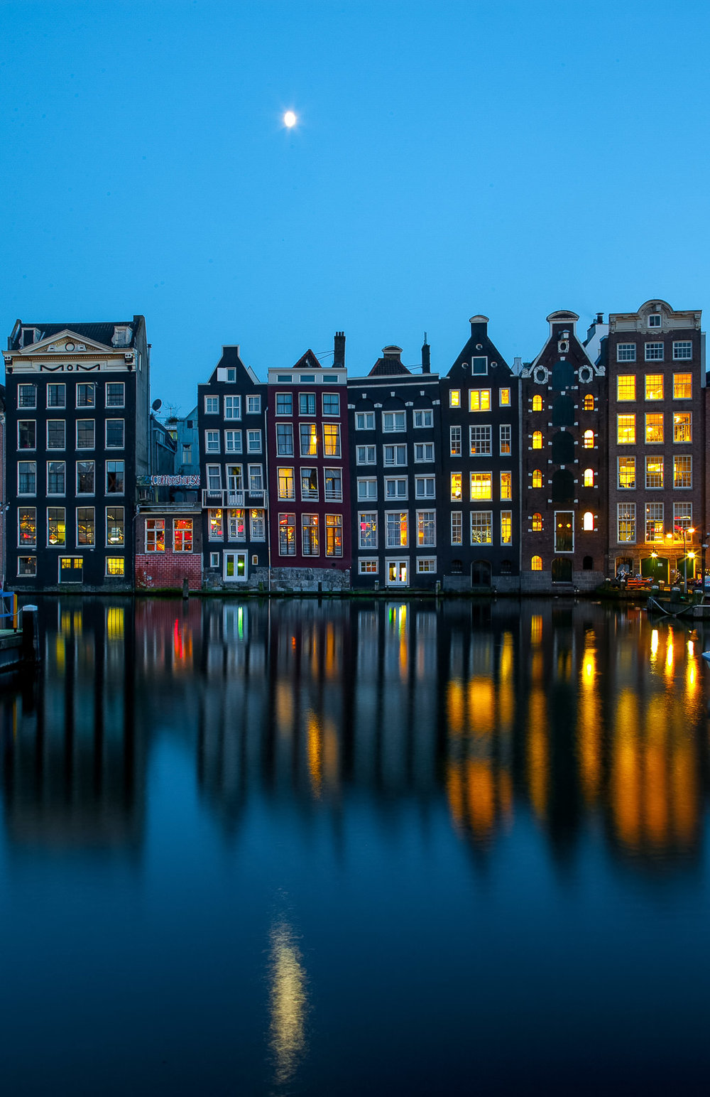 Amsterdam windows reflecting in water. Artem Savateev