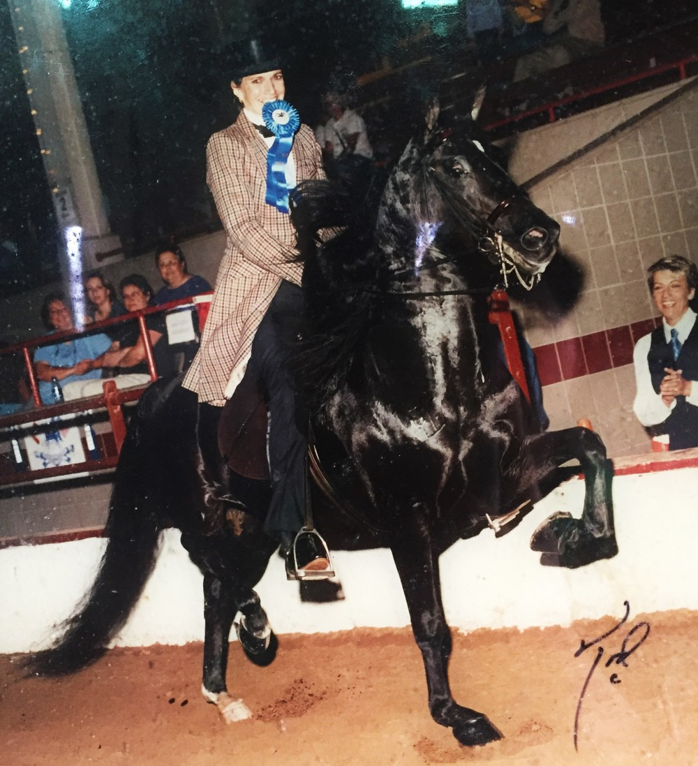 Mom with her blue ribbon stallion, Edoxus.  She didn't get to this level by letting fear or failure hold her back!