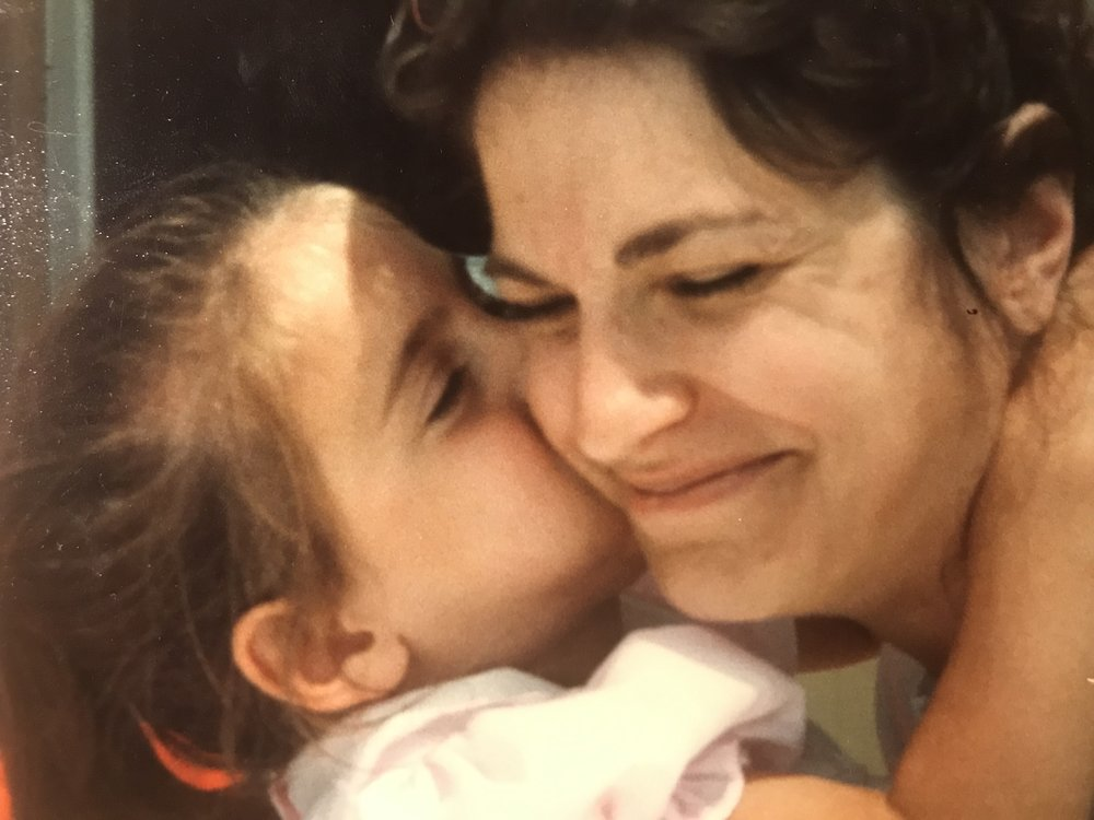 My mom and me when I was little, happy in each other's presence.