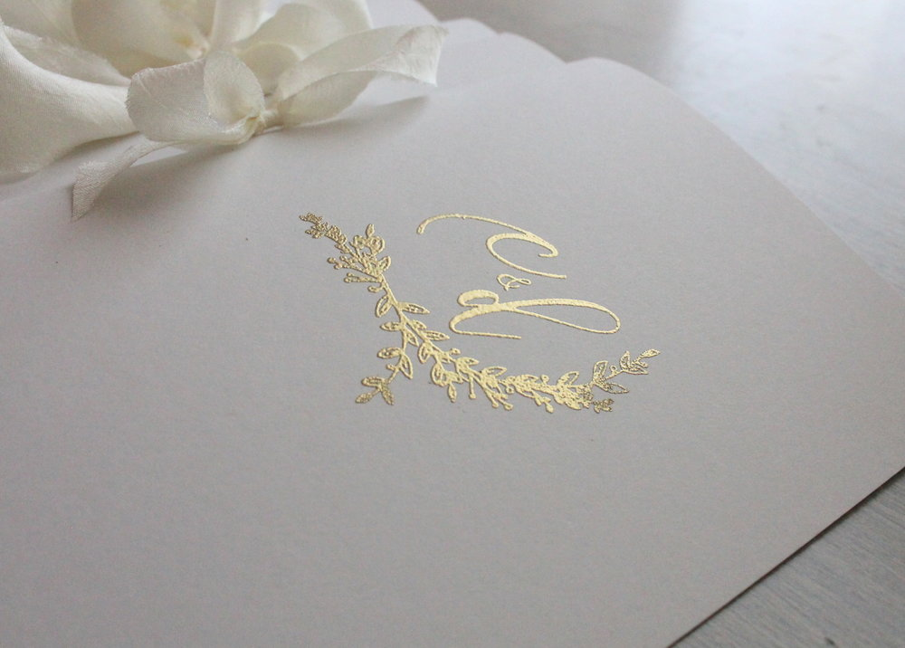 Gold embossed wedding programs