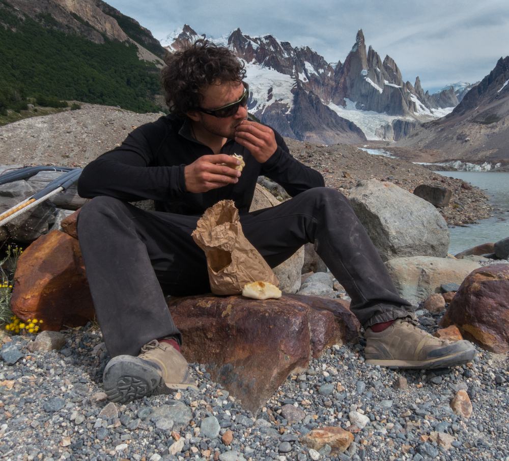Jonathan Schaffer mowing down Empanadas, Patagonian super food, en route to the Torre Valley