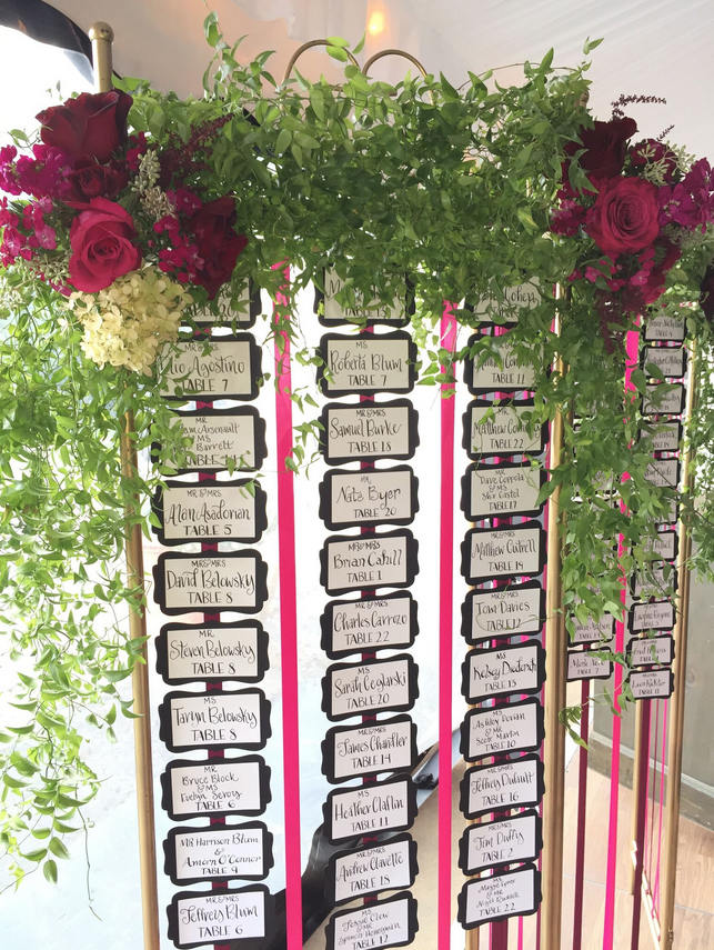 A simple room divider transformed into a fab Escort Card display.