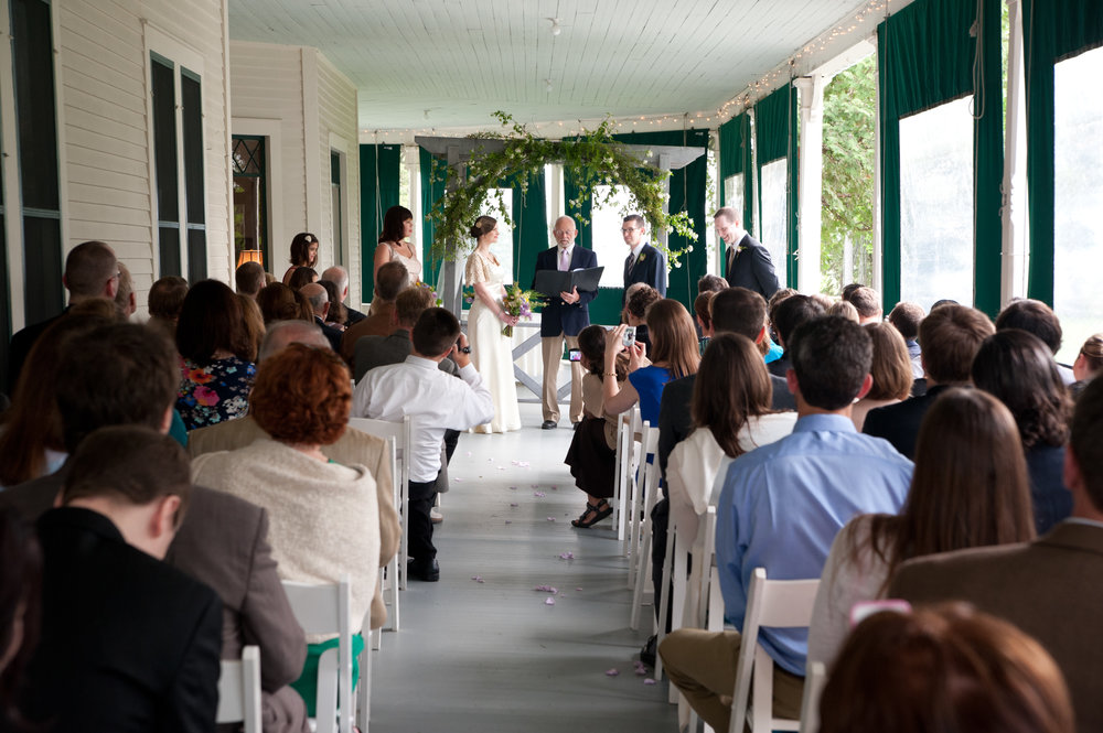 Here's a ceremony that had to be brought up onto the porch at the Grand Isle Lake House captured by North Photography.