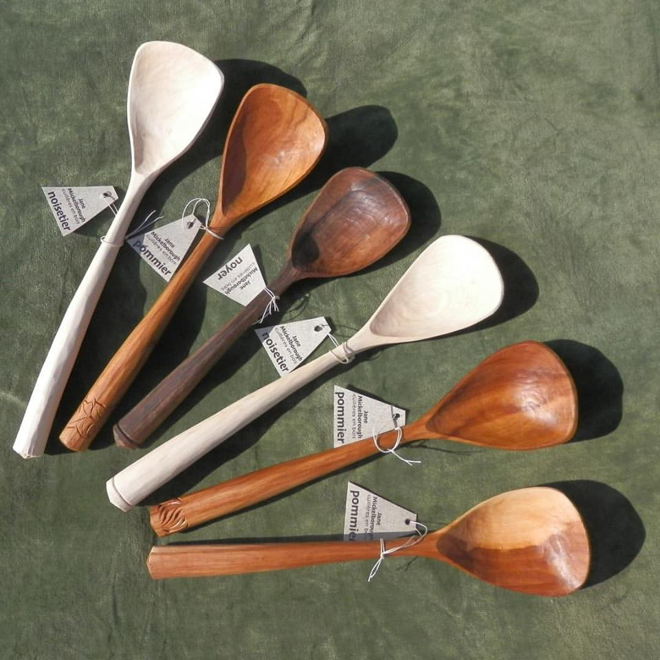 Eating spoons carved from a variety of woods by Jane Mickelborough