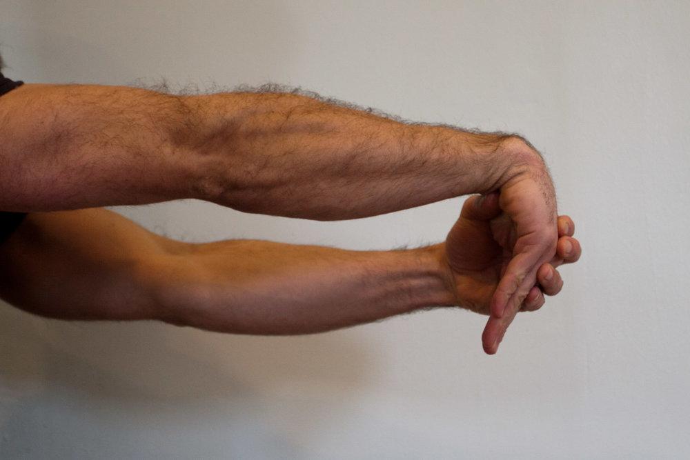 Palm down wrist stretch