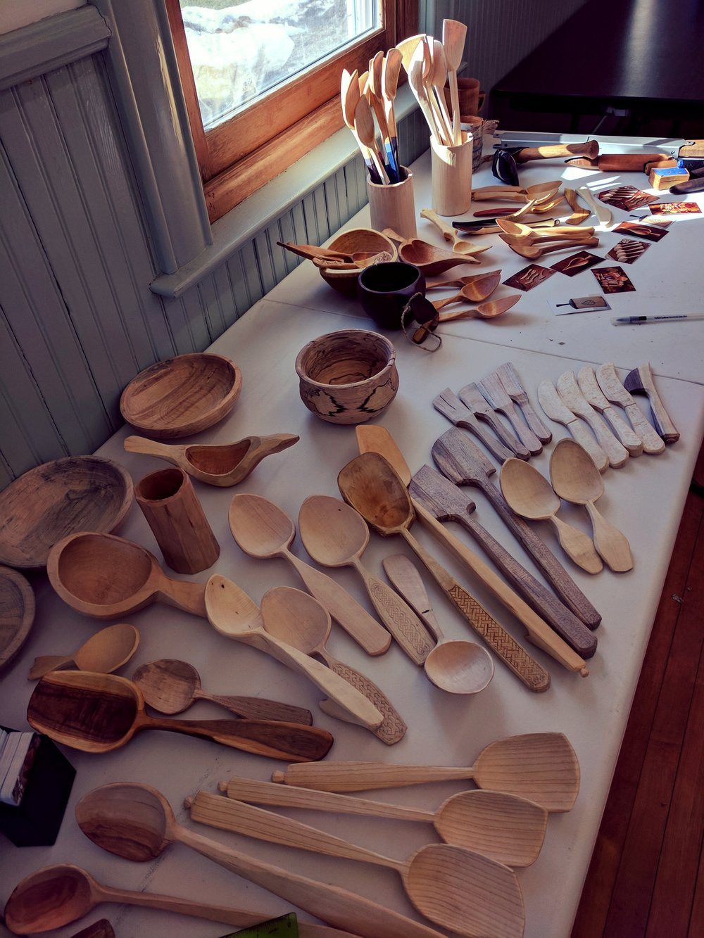 Handmade wood spoons and bowls. Foreground work is mine, background work is  Derek's .