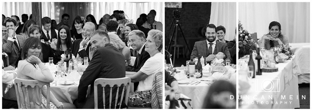 Rustic Barn Wedding in Somerset - Guests Laughing at Speeches