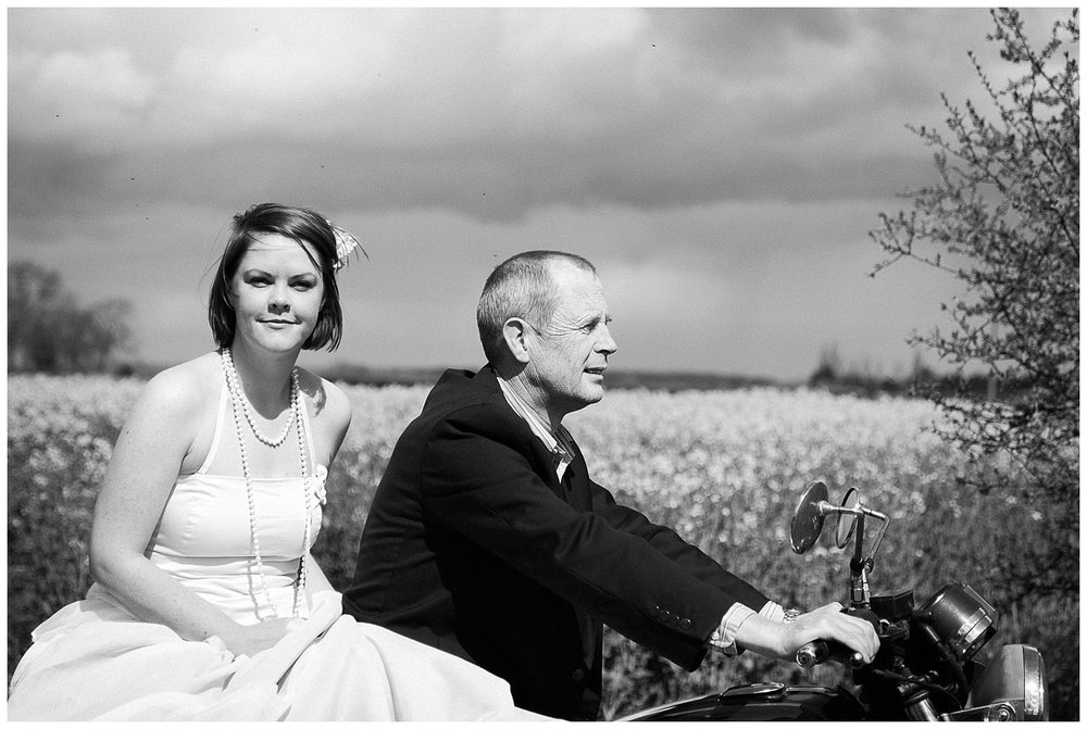 Motorbike Themed Engagement Shoot - Bride and Groom Sat On Bike
