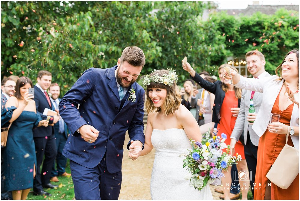 Wedding at Goldney Hall - Bride and Groom confetti shot