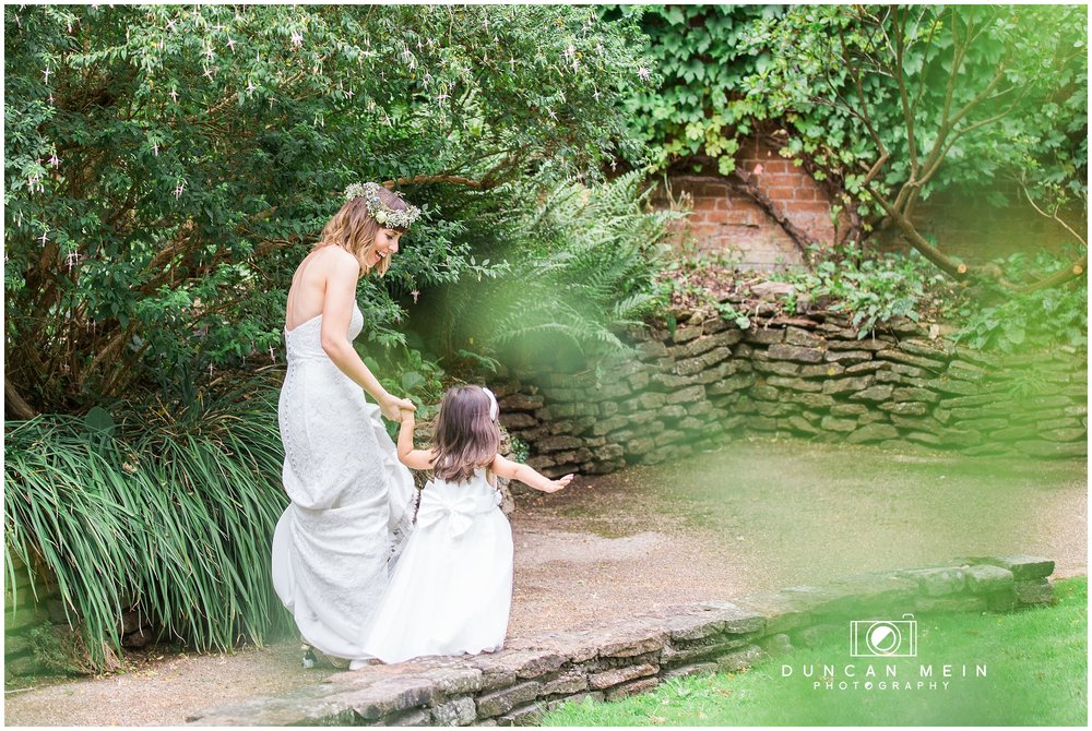 Wedding at Goldney Hall - Bride and Flower Girl in the grounds