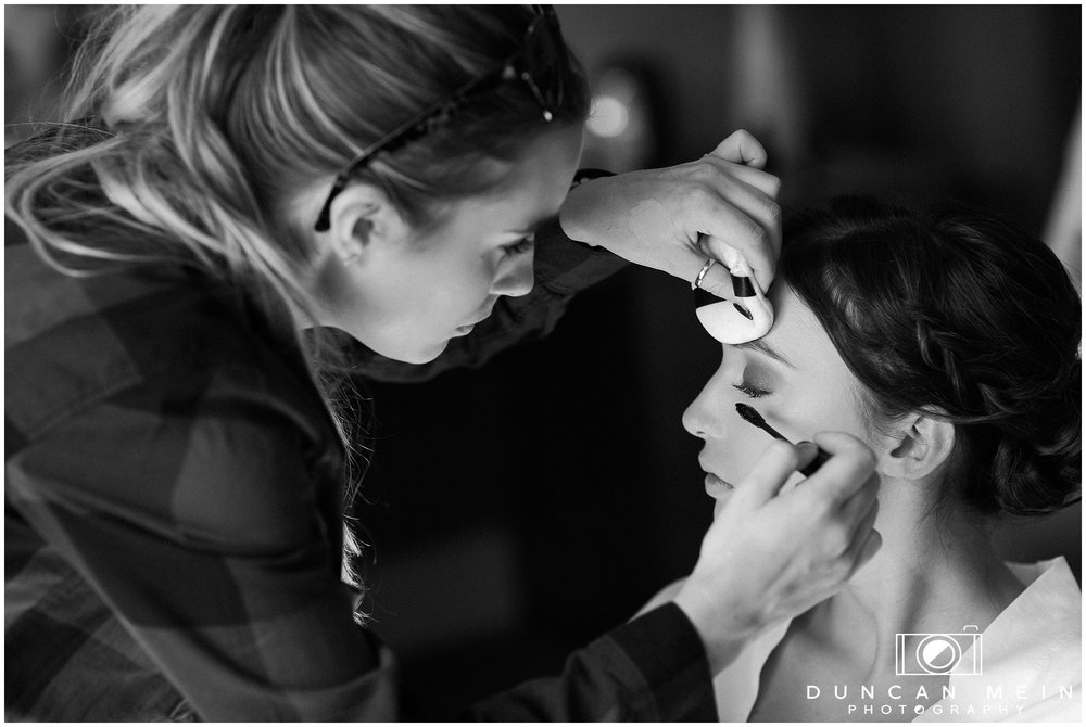 Wedding in Crudwell Village - Bridesmaid getting makeup done