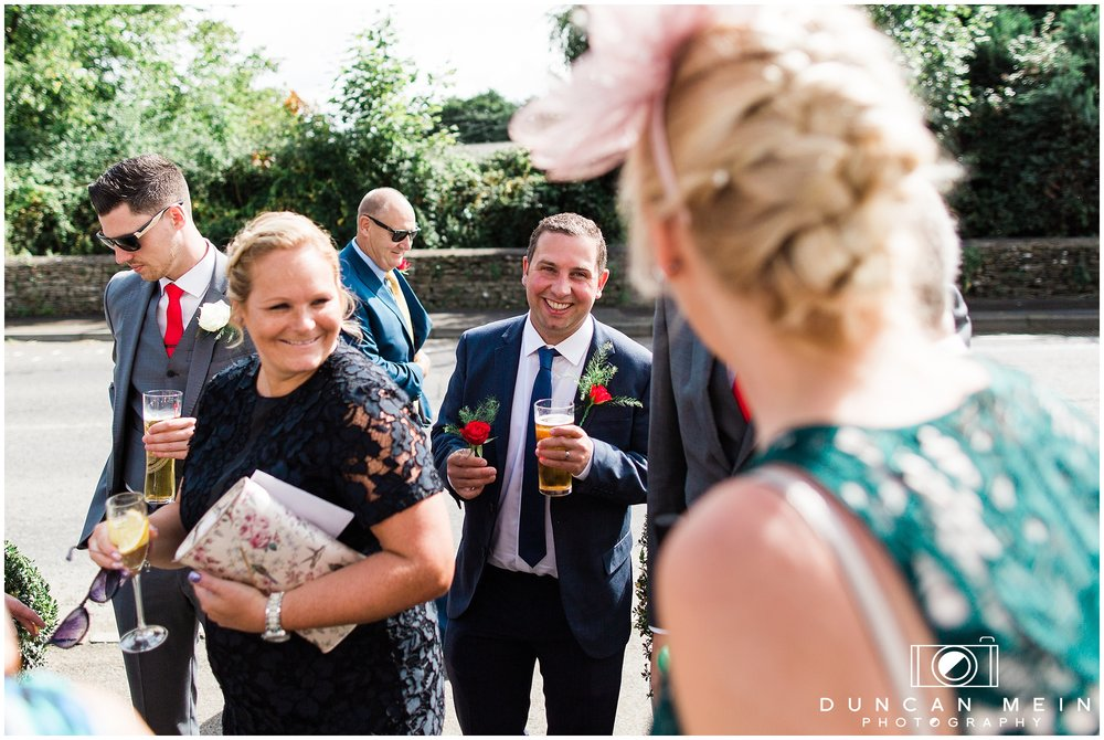 Wedding in Crudwell Village - Guests before the ceremony
