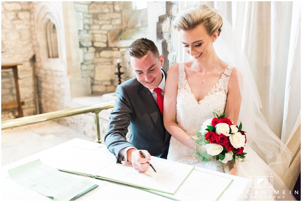 Wedding in Crudwell Village - Signing the Register
