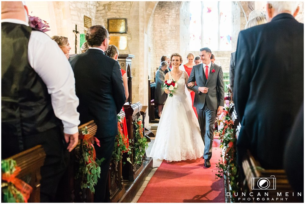 Wedding in Crudwell Village - Bride and Groom leaving the church