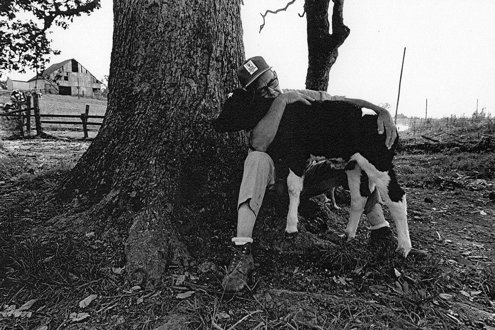farmer hugging calf horiz laser.jpg