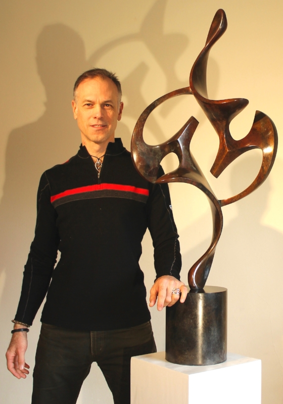 Sculptor Dave Stevenson inside his Chelsea studio with commissioned bronze, Acrobat