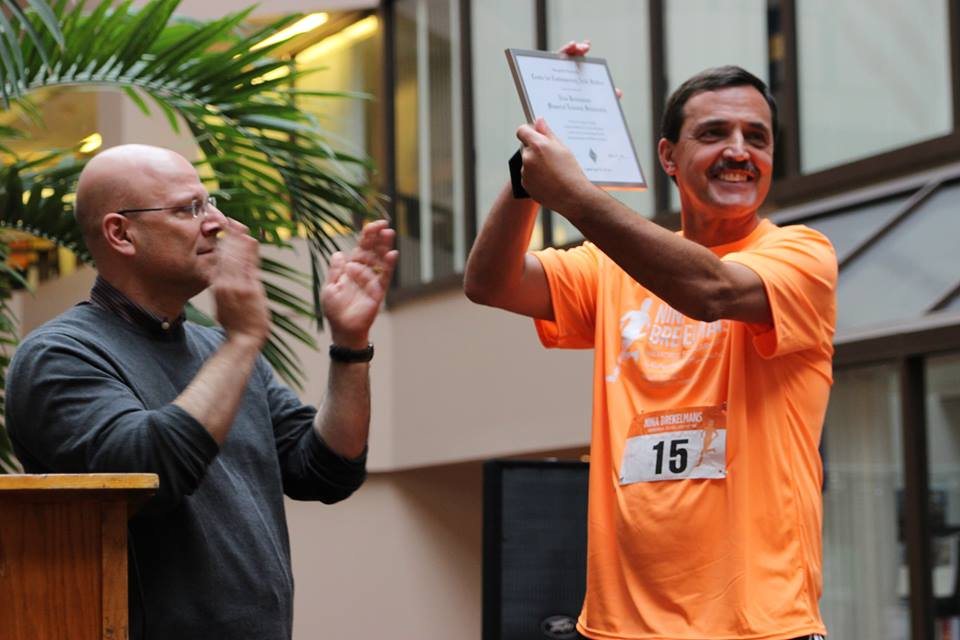 Dr. Joel Hellman, Dean of Georgetown's School of Foreign Service, presents Nina's father, Nico Brekelmans, with a certificate acknowledging the completion of the Nina Brekelmans Memorial Endowed Scholarship during a post-race ceremony at the Nina Brekelmans Memorial Scholarship 5K. -- March 19, 2016