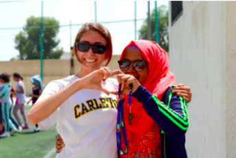 Maddie Ulanow , US director of Reclaim Childhood (left) with  Coach Rahaf (Zarqa)  (right)