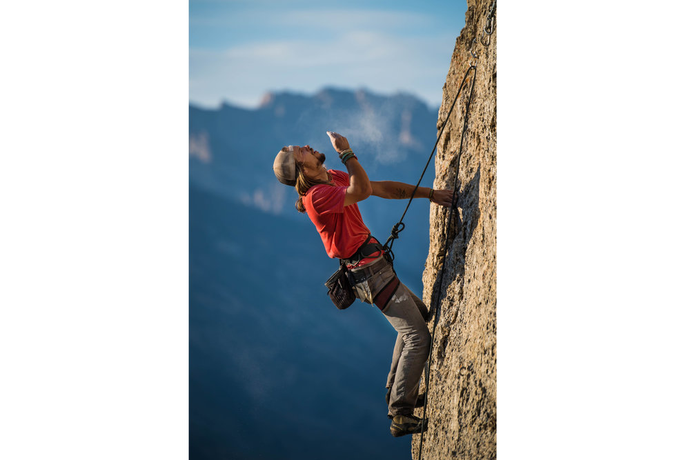 Climber blowing chalk horizontal.jpg