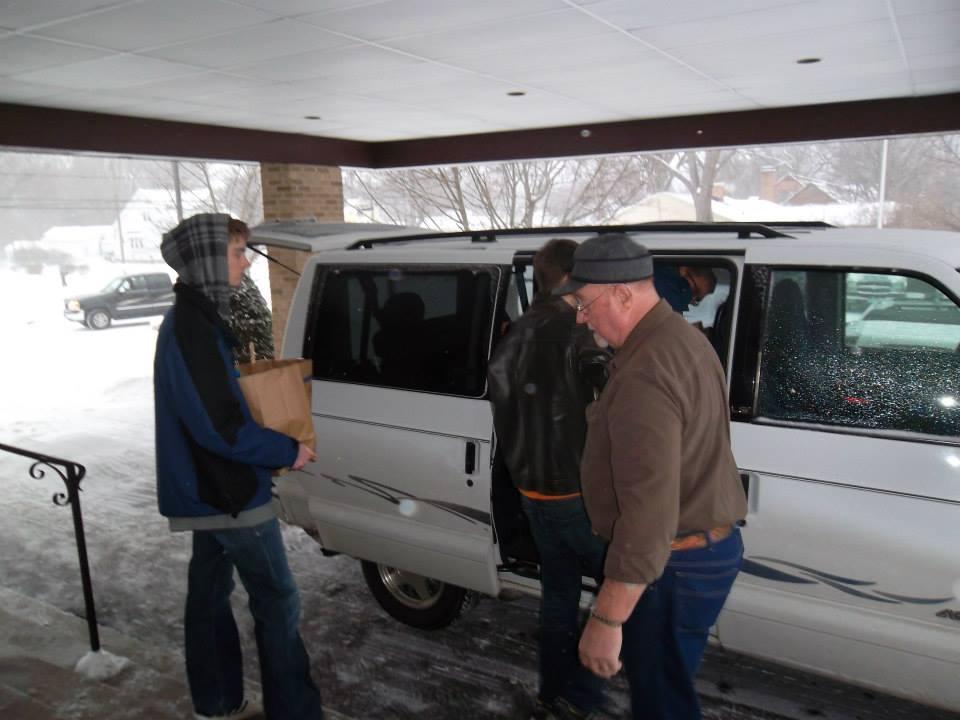 Loading food for the Christmas Food Drive.