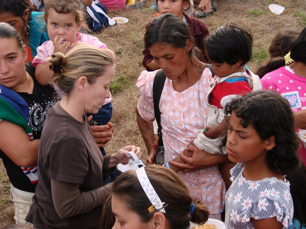 Our Founder and missionary, Robyn, helping the beautiful people in Zambrano, Honduras