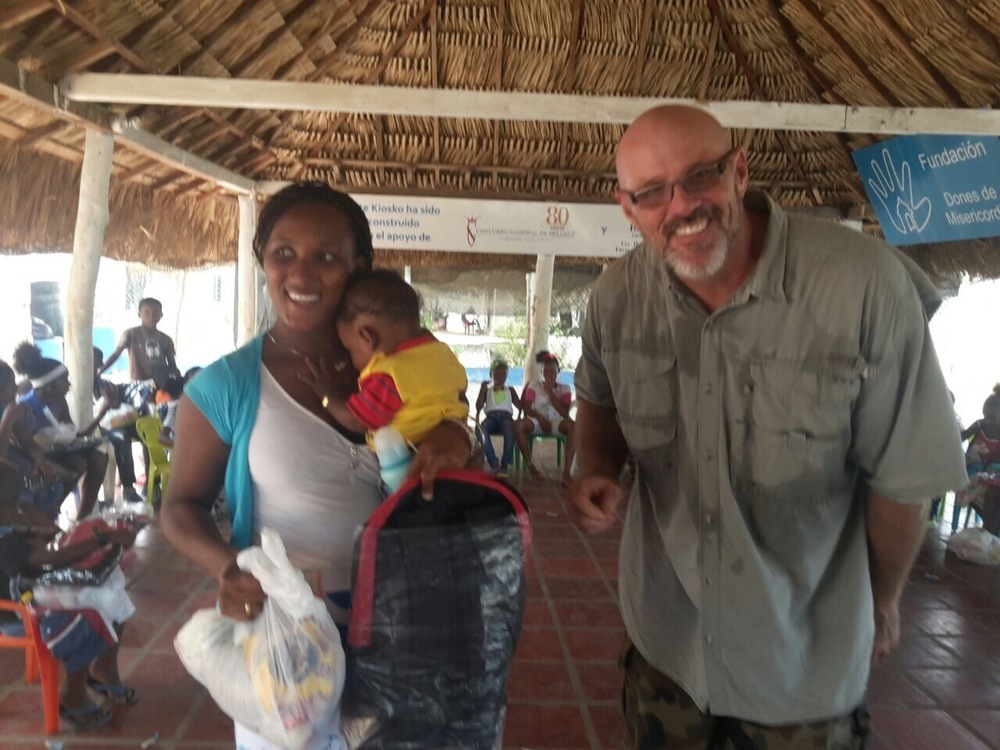 Our Founder and President, Ernie, with the people of Tierra Bomba