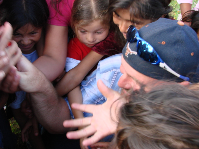 Our Founder and President, Ernie, giving away Skittles to the children in Zambrano, Honduras