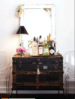 repurposed black trunk as bar cart.jpg