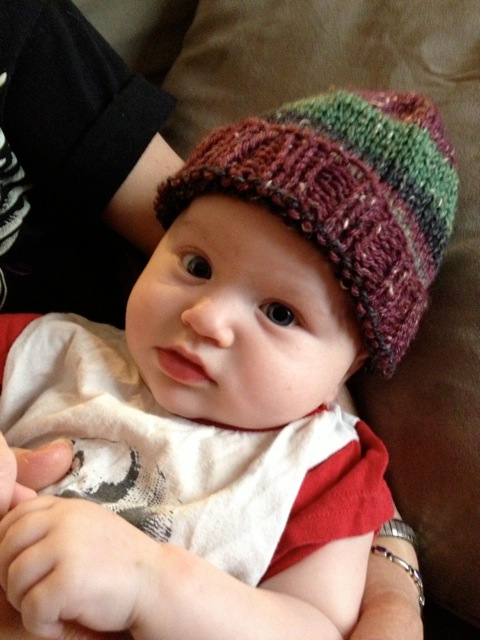 elliot likes his new C de Lulu hat.jpeg