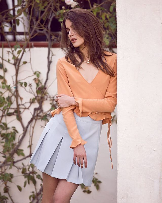 Saul's wrap tops are selling out like mad!  Hurry and get yours -- Orange, black and baby blue! ✨ vialosangeles.com #BabeOfBelAir
