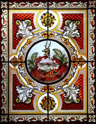 Vermont's state seal, in a stained-glass window in the State House, in Montpelier.