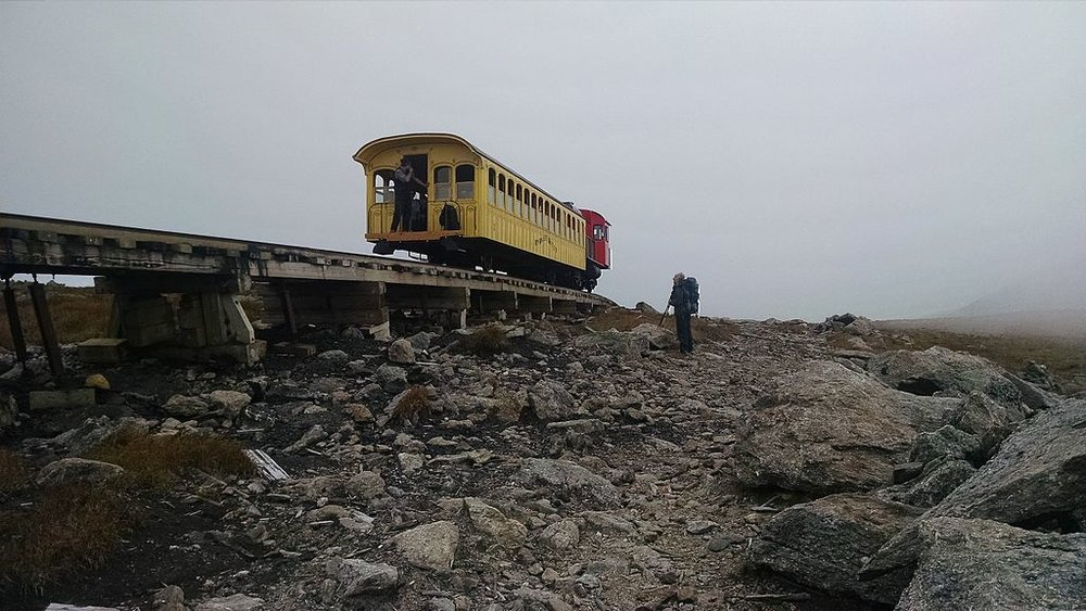 The Mt. Washington Cog Railroad goes by a hiker above the tree line.    -- Photo by David W. Brooks