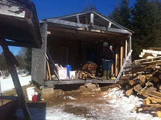 "A ""sugar shack,'' where maple sap is boiled off to make syrup."