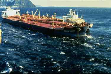 The Exxon Valdez, aground and leaking massive amounts of oil in Prince William Sound, Alaska.