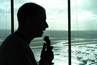 Air-traffic controller talking with pilots.