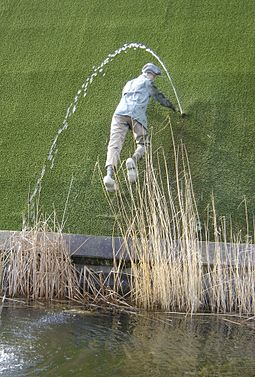 Tourism statue in Madurodam, Netherlands, of a legendary, nameless boy plugging a dike.