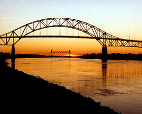 The Bourne Bridge, over the Cape Cod Canal, with the Cape Cod Canal Railroad Bridge in the distance.