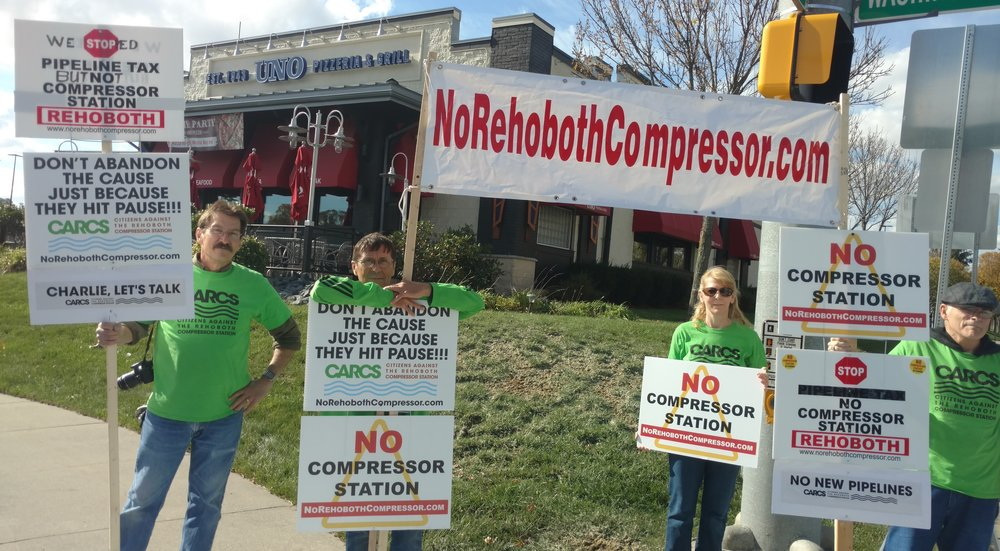 Opponents of a proposed natural-gas pipeline compressor station recently protested outside a local restaurant, where Gov. Charlie Baker stumped for Attleboro's mayor.    -- Photo by Tim Faulkner for ecoRI News