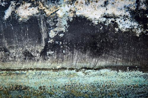 Photo by Richard Alan Cohen at the Westport (Mass.) Free Library all this month in a show with David Feigenbaum sponsored by the Westport Art Group. Mr. Cohen presents abstract landscapes seen in waterline residues and corrosion on the hulls of boats.