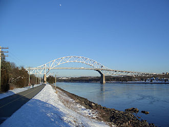 The Bourne Bridge,  over the Cape Cod Canal, one of three bridges (one is a railroad span) connecting Cape Cod with the Massachusetts mainland.